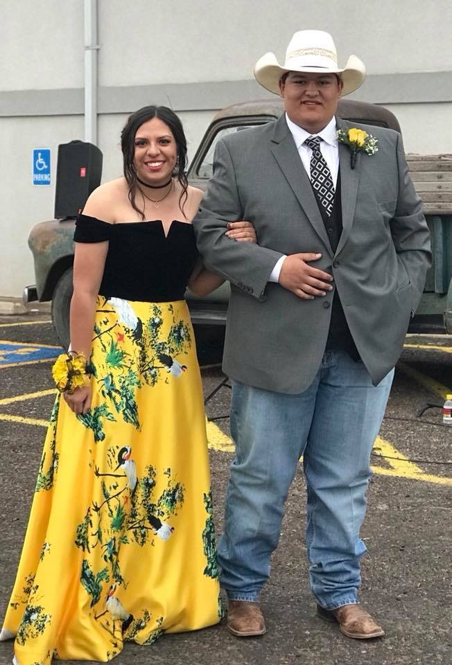 Ethan Pray and Naomi Nanez walking into their  junior prom in 2018